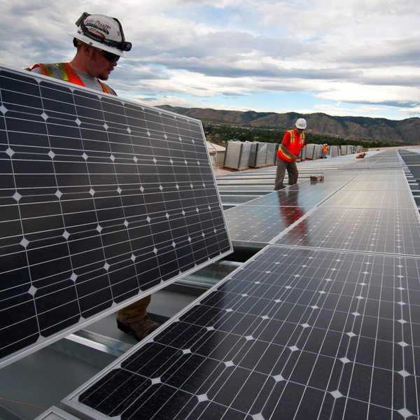 Workers install energy solar panels